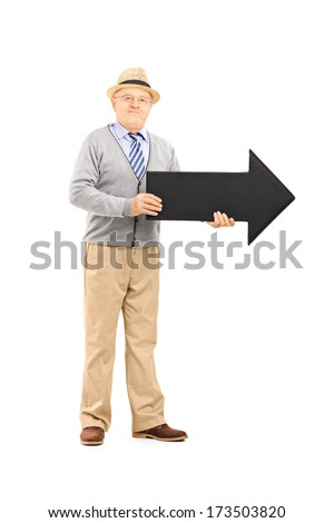 Full length portrait of senior gentleman holding big black arrow pointing right isolated against white background