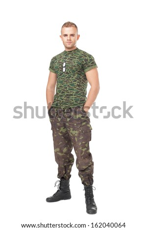 Full length portrait of serious army soldier isolated on white background