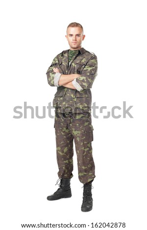 Full length portrait of serious army soldier with his arms crossed isolated on white background