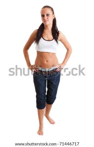 Full-length portrait of sexy young woman in blue jeans and white sports jersey
