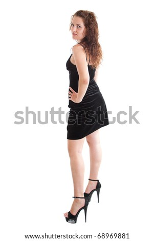 Full-length portrait of sexy young woman in dress