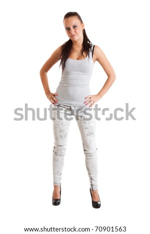 Full-length portrait of sexy young woman in torn white jeans and gray sports jersey