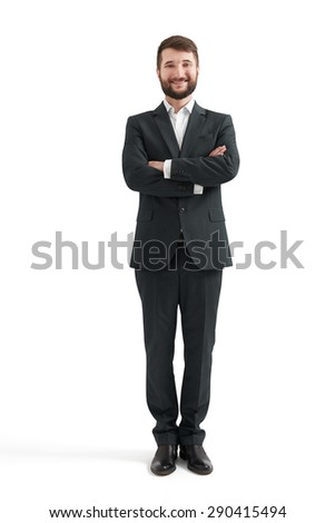 full-length portrait of smiley businessman in formal wear with folded hands looking at camera. isolated on white background - stock photo