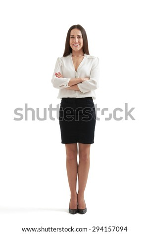 full-length portrait of smiley businesswoman in formal wear with folded hands. isolated on white background - stock photo