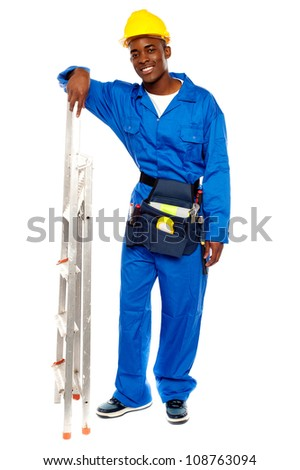 Full length portrait of smiling african worker resting hand on stepladder
