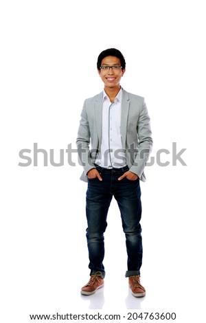 Full length portrait of smiling asian man isolated on a white background - stock photo