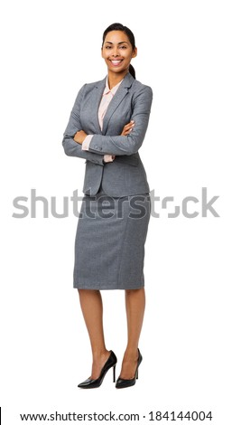 Full length portrait of smiling businesswoman standing arms crossed isolated over white background. Vertical shot. - stock photo