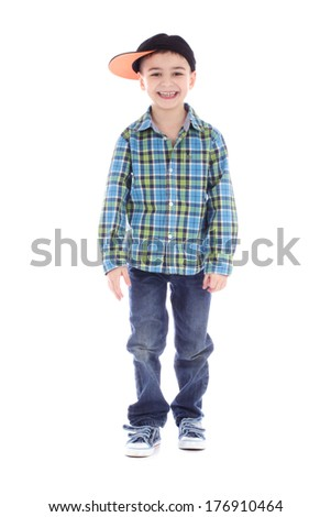Full length portrait of smiling little boy in jeans and cup dancing hip-hop on white background - stock photo
