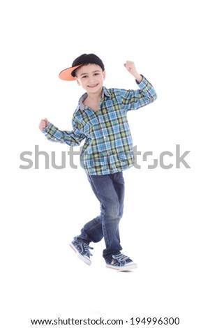 Full length portrait of smiling little boy in jeans on white background - stock photo