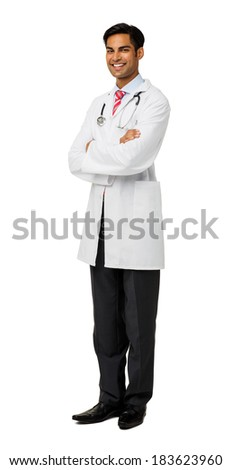Full length portrait of smiling male doctor with arms crossed standing isolated over white background. Vertical shot. - stock photo