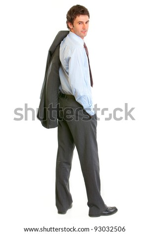 Full length portrait of smiling modern businessman looking back