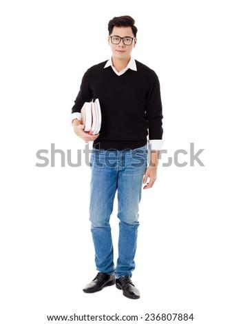 Full length portrait of  smiling school boy holding books - stock photo