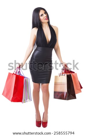 Full length portrait of stylish beautiful woman holding shopping bags over white  background - stock photo