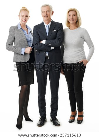 Full length portrait of successful business team standing against white background.  - stock photo