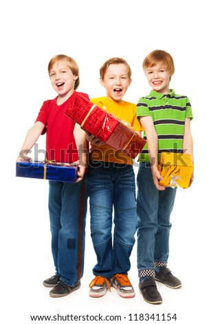 full length portrait of three boys with presents laughing at camera