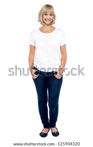 Full length portrait of trendy middle aged woman dressed in fashion casuals. - stock photo