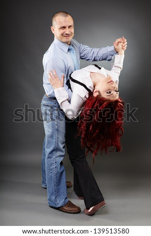 Full length portrait of two business partners dancing - stock photo