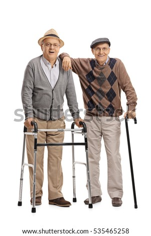 Full length portrait of two elderly men with a walker and a cane isolated on white background