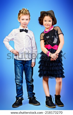 Full length portrait of two modern kids posing together. Fashion shot.   - stock photo
