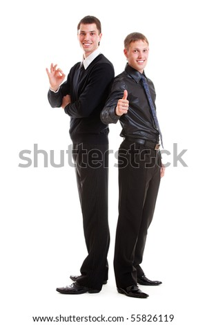 full-length portrait of two prosperous young businessmen. isolated on white background - stock photo