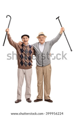 Full length portrait of two senior gentlemen posing together and celebrating something isolated on white background