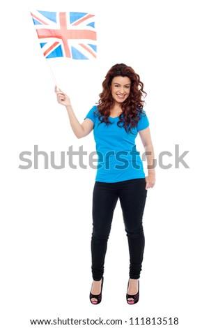 Full length portrait of UK female supporter posing with flag - stock photo