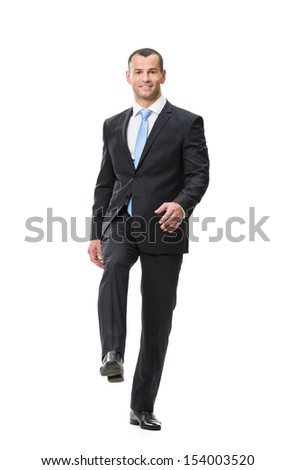 Full-length portrait of walking businessman, isolated on white. Concept of leadership and success