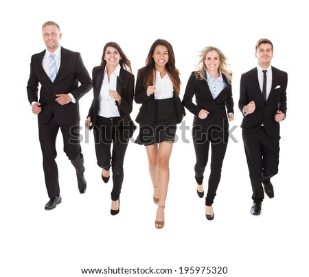 Full length portrait of welldressed businesspeople running against white background - stock photo
