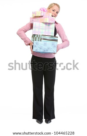 Full length portrait of woman holding stack of present boxes - stock photo