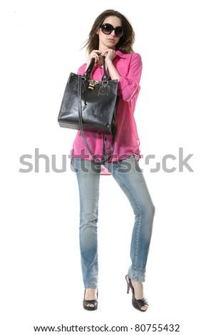 Full length portrait of woman in sunglasses posing - stock photo