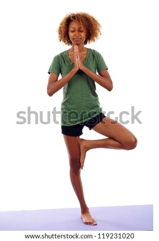 Full length portrait of young beautiful black woman doing yoga exercise isolated over white background - stock photo