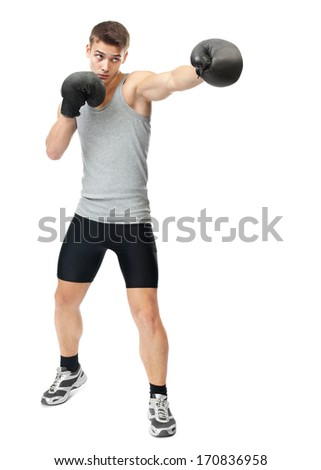Full length portrait of young boxer making punch isolated on white background - stock photo