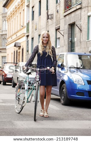 Full length portrait of young business woman going to work by bike. Business people. - stock photo