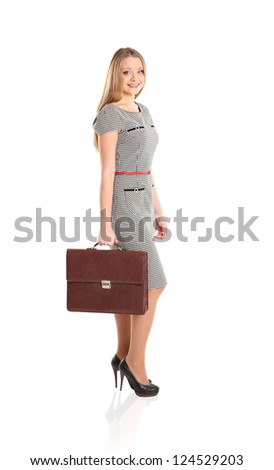 Full length portrait of young business woman holding briefcase in hand isolated on white