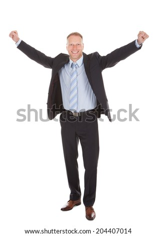Full length portrait of young businessman celebrating success over white background - stock photo