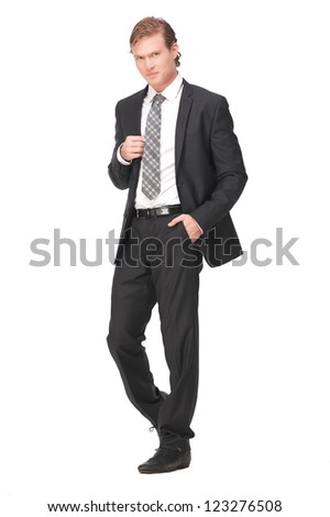 Full length portrait of young businessman holding his black suit jacket and isolated on white background - stock photo