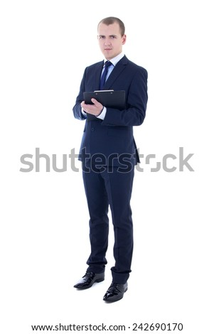 full length portrait of young businessman in suit holding clipboard isolated on white background