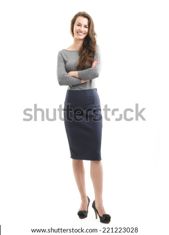 Full length portrait of young businesswoman standing against white background.  - stock photo