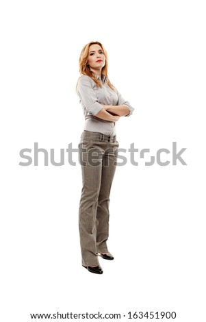 Full length portrait of young confident businesswoman with arms folded, isolated on white background - stock photo