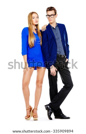 Full length portrait of young fashionable couple over white background. Isolated. - stock photo
