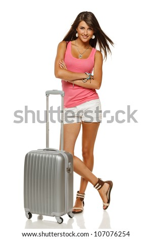 Full length portrait of young female standing with suitcase going on holidays isolated on white background - stock photo