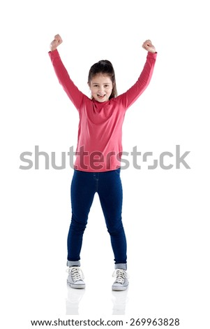 Full length portrait of young girl cheering with her hands raised on white background - stock photo