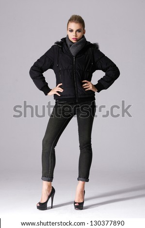 full-length portrait of young girl isolated on gray background - stock photo