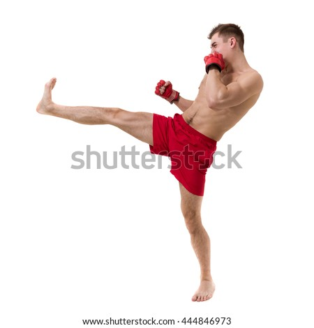 Full length portrait of young male boxer showing some movements against isolated white background