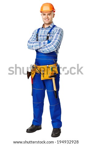 Full length portrait of young male construction worker wearing protective clothes, helmet and tool belt isolated on white background
