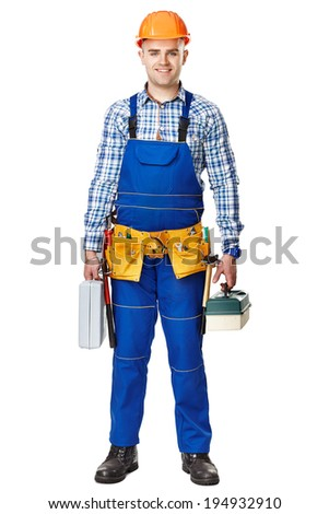 Full length portrait of young male construction worker with toolboxes wearing protective clothes, helmet and tool belt isolated on white background