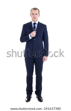 full length portrait of young male reporter with microphone isolated on white background - stock photo