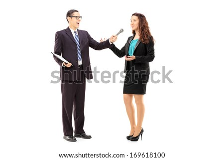 Full length portrait of young man conducting survey on woman, isolated on white background