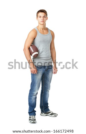 Full length portrait of young man holding rugby ball isolated on white background - stock photo