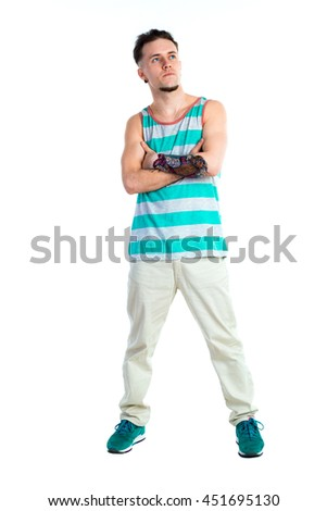 full length portrait of young man in casual clothes looking away isolated on white background